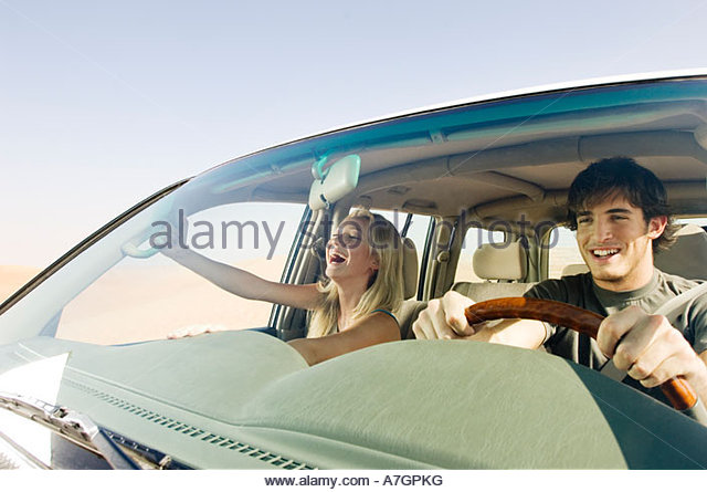 A young couple in a car - Stock Image