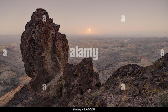 USA, Arizona, Kofa National Wildlife Refuge, Full Moon Rising from Castle Dome - Stock Image