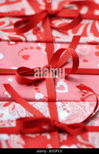 Three gift wrapped presents, cropped - Stock Image