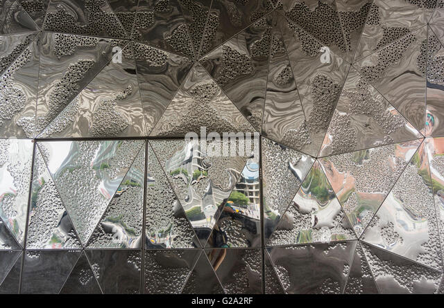 Mirror composition at Forum Building by Jacques Herzog and Pierre de Meuron. Barcelona. Catalonia. Spain. - Stock Image