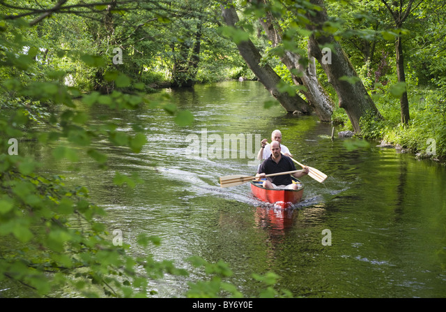 Two men canoeing on Wuerm River in southern Bavaria, Upper Bavaria, Germany - Stock Image