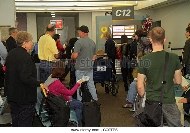 Louisiana New Orleans Louis Armstrong New Orleans International Airport MSY terminal flight boarding gate passenger - Stock Image