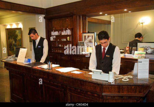 Buenos Aires Argentina Avenida de Mayo Hotel Mundial hospitality lodging business front desk Hispanic man clerk - Stock Image
