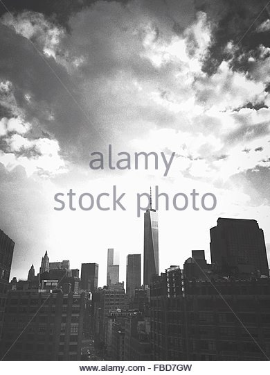 One World Trade Center Amidst Buildings Against Cloudy Sky In City - Stock Image