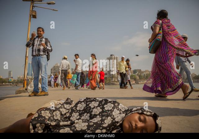 Mumbai (Bombay), India street child sleeping on - Stock Image