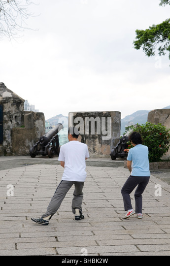 A couple practice Tai Chi in the Lou Lim Ioc Garden in Macau - Stock Image