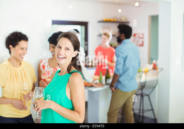 Woman laughing at party - Stock Image