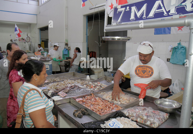 Panama City Panama Ancon Mercado de Mariscos market merchant shopping selling retail shrimp seafood business stall - Stock Image