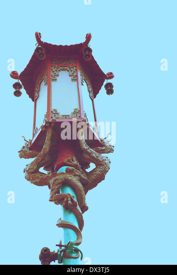 Chinatown ornate Chinese street lamp lantern with dragons, San Francisco, California, United States, toned image, - Stock Image