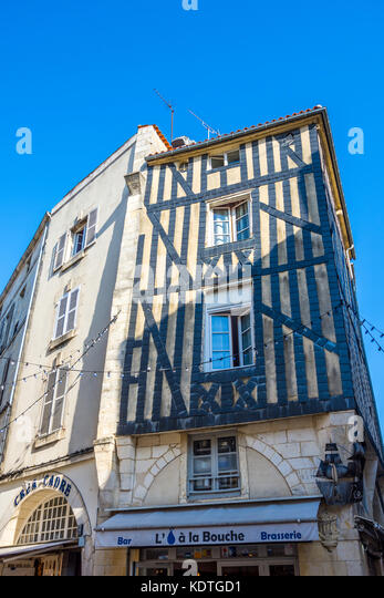 Detail of old buildings with slates protecting timbers from salty air, La Rochelle, France. - Stock Image