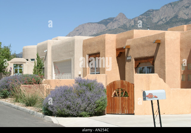 Albuquerque New Mexico Sandia Heights adobe style homes high desert T - Stock Image