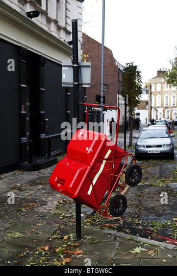 A postman trolley hanging. Camden. London - Stock Image