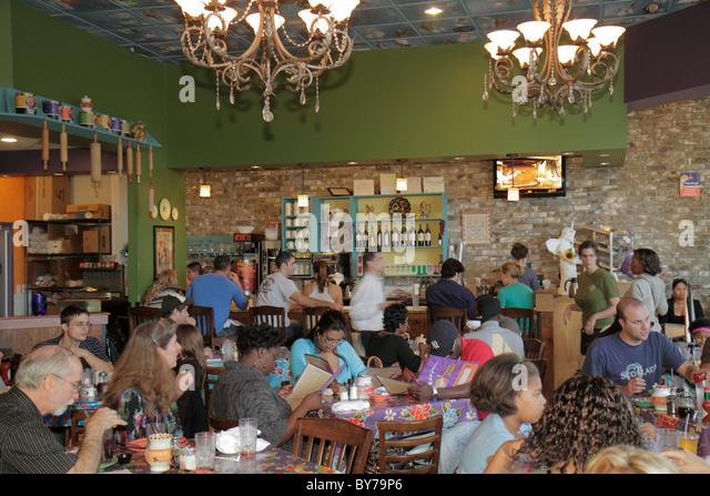 Atlanta Georgia Buckhead Peachtree Street Terminus Flying Biscuit Cafe restaurant business casual dining Black woman - Stock Image