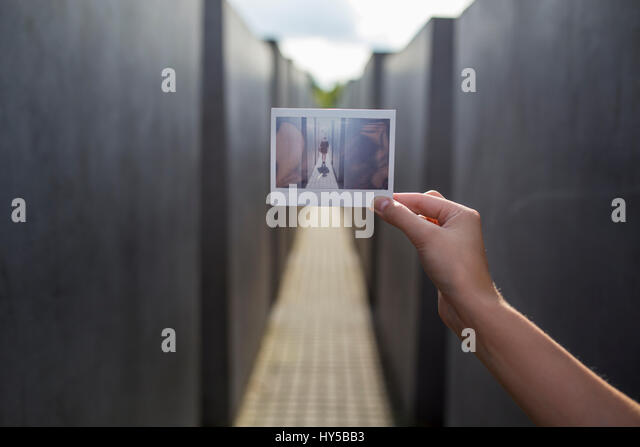 Germany, Berlin, Polaroid photograph in front of Holocaust Memorial - Stock Image