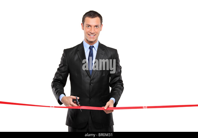 A man cutting a red ribbon, opening ceremony - Stock Image