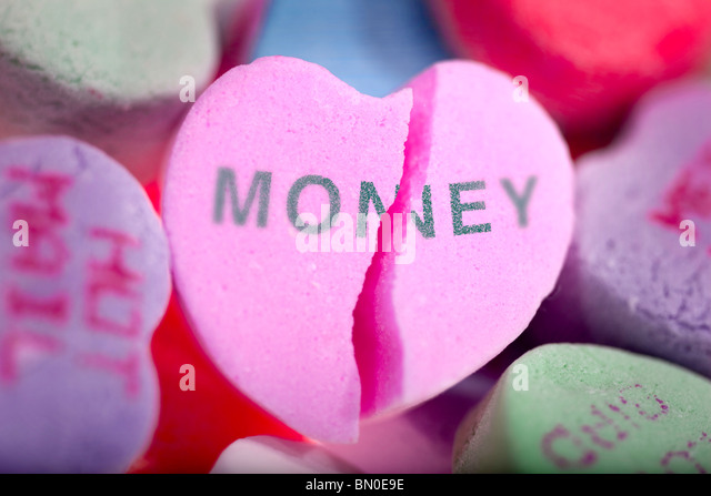 Money vs. Love - Stock Image