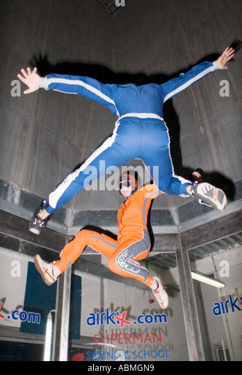 2 skydivers practising inside AirKix at the Xscape building in Central Milton Keynes, the Centre MK - Stock-Bilder