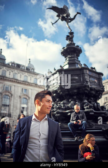 A young Japanese man sightseeing in London - Stock Image