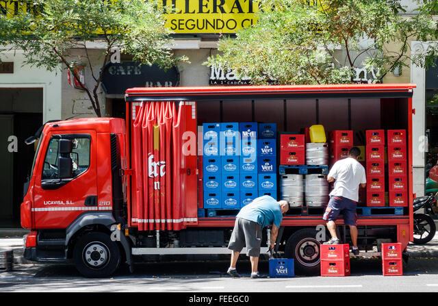 Madrid Spain Europe Spanish Hispanic Chamberi Calle de Genova truck van lorry delivery man working driver beer water - Stock Image