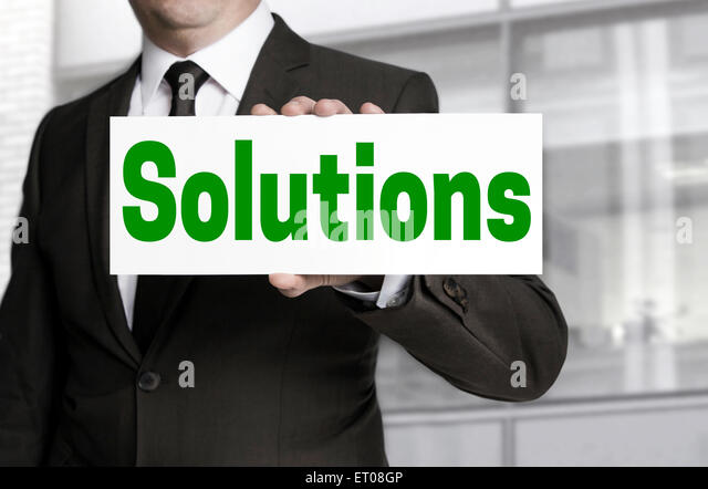 Solutions sign is held by businessman. - Stock Image