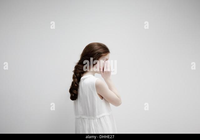 Girl posing sideways for camera - Stock Image