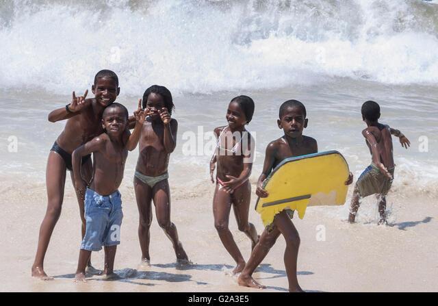 Rio de Janeiro Copacabana beach kids with surf board - Stock Image