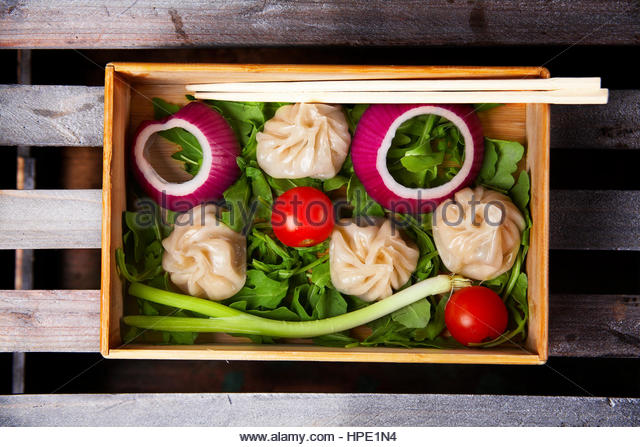 Shrimp dumplings with vegetables and greens - Stock Image
