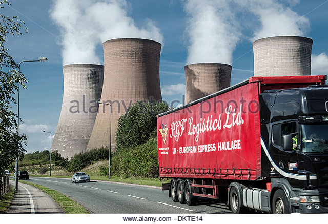 Rugeley power station next to busy road. Photographed in Rugely, Staffordshire. - Stock Image