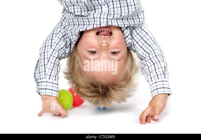 Baby boy handstand - Stock Image