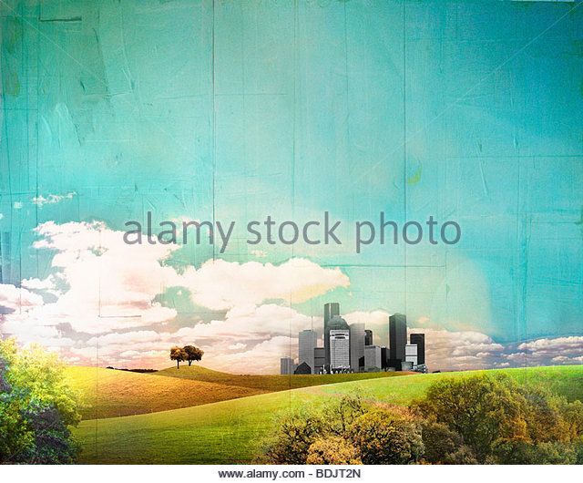 Distant cityscape behind rolling landscape - Stock Image