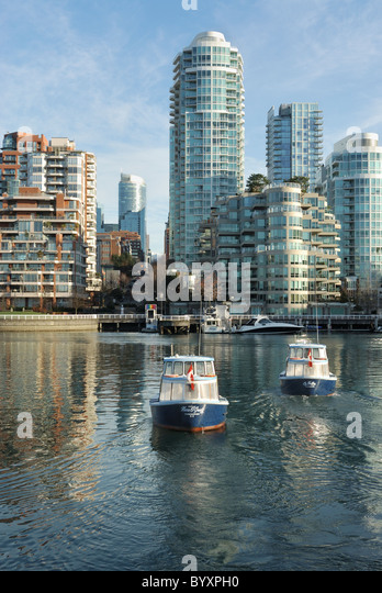 Water taxis ferrying passengers from the North side to the south side of False Creek. - Stock Image