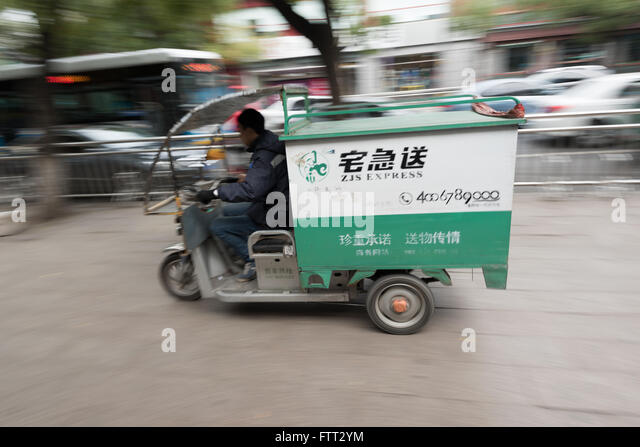 Beijing, China - October 25, 2015: Local courier company in Beijing, delivering goods with an electric vehicle - Stock Image