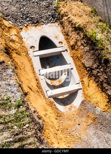 New pre-cast concrete storm drain in ditch - France. - Stock Image