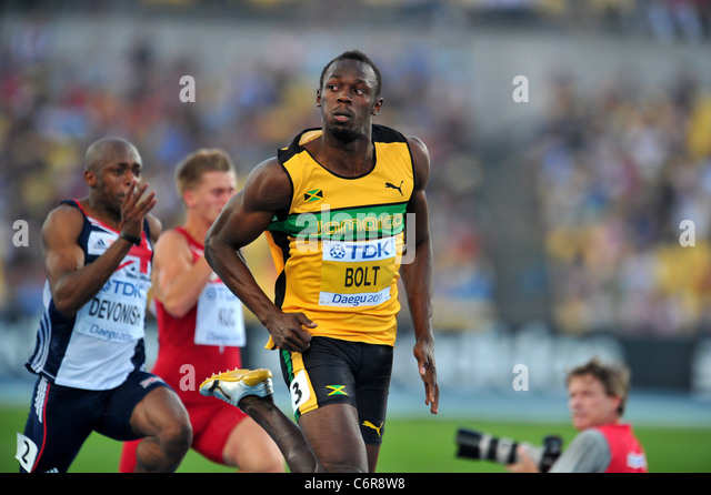 Usain Bolt (JAM) performing for the 13th IAAF World Championships in Athletics. - Stock Image