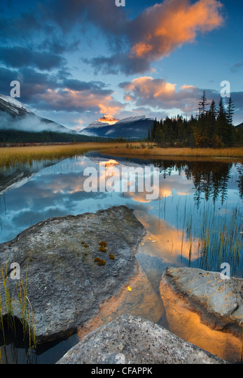Scenic with water reflections of Rampart Ponds and Mount Athabasca, Banff National Park, Alberta, Canada - Stock Image