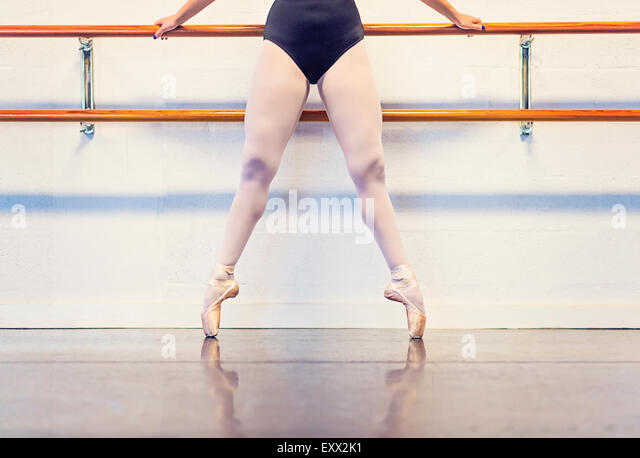 Young woman dancing in dance studio - Stock-Bilder