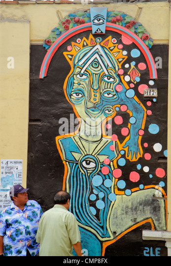 Lima Peru Barranco District Calle Colon neighborhood scene street art graffiti Hispanic man - Stock Image