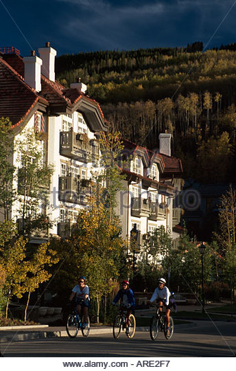 Colorado Rocky Mountains Vail bikers pass Sonnenalp Bavaria Haus ski resort fall colors - Stock Image