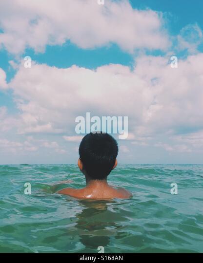 Boy swimming in the sea - Stock-Bilder