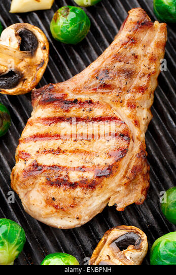 Grilled pork chop with brussels sprouts - Stock Image