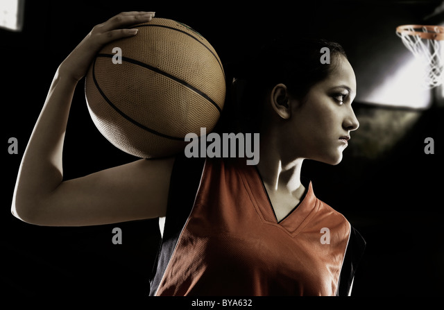 Girl posing with a basketball - Stock-Bilder