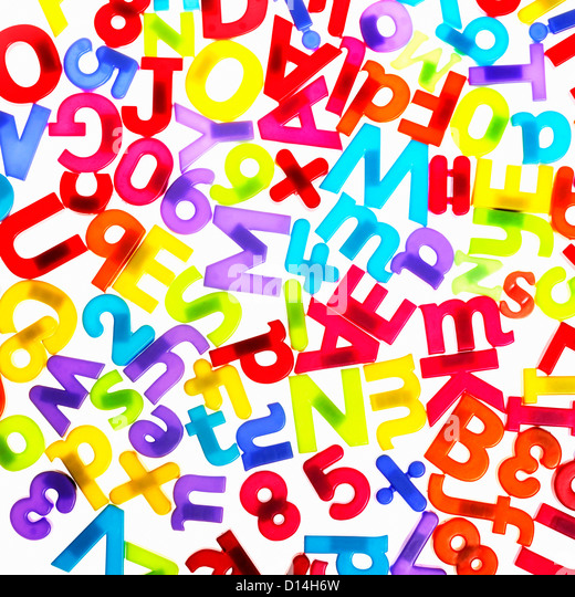 Colorful plastic letters and numbers - Stock Image