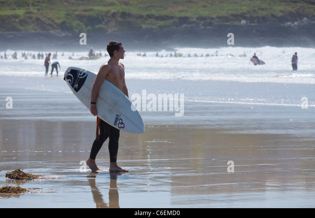 fistral beach surfers entering the water newquay Cornwall England UK GB EU England - Stock Image