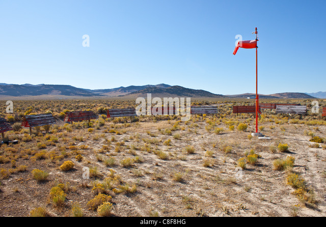 An image of a lonely windsock on a Nevada Desert Airport. - Stock Image