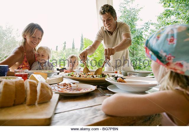 Family eating dinner - Stock-Bilder