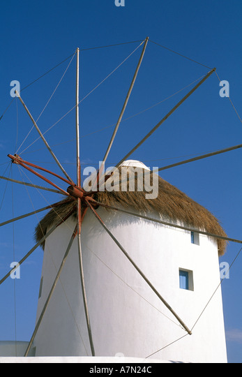 GREECE Mykonos white windmills thatch roofs national symbol iconic image blue sky background - Stock Image