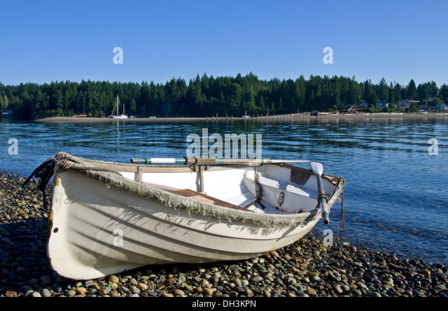 Dory rowboat on the beach Puget Sound Washington - Stock Image