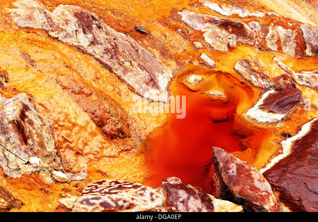 Stream of oxidized iron minerals. Río Tinto, Huelva province. Spain - Stock Image