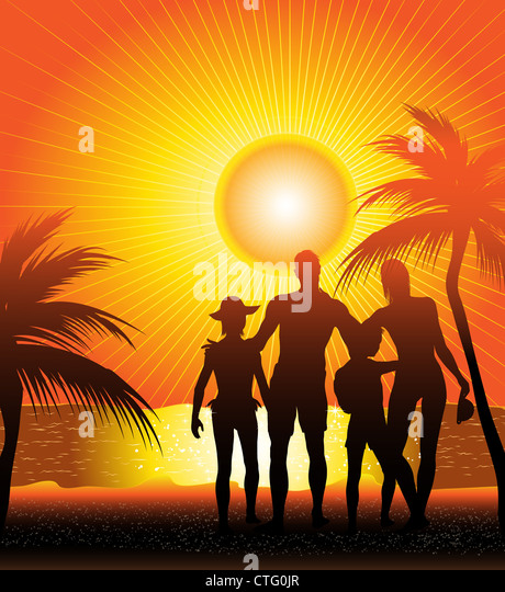 family silhouette on sunset beach - Stock Image