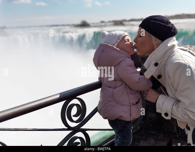 Mother kissing her two year old girl at Niagara Falls, Ontario, Canada. - Stock Image
